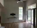 Living room has been painted a light gray. - 9812 SPANISH OAK WAY #118, BOWIE