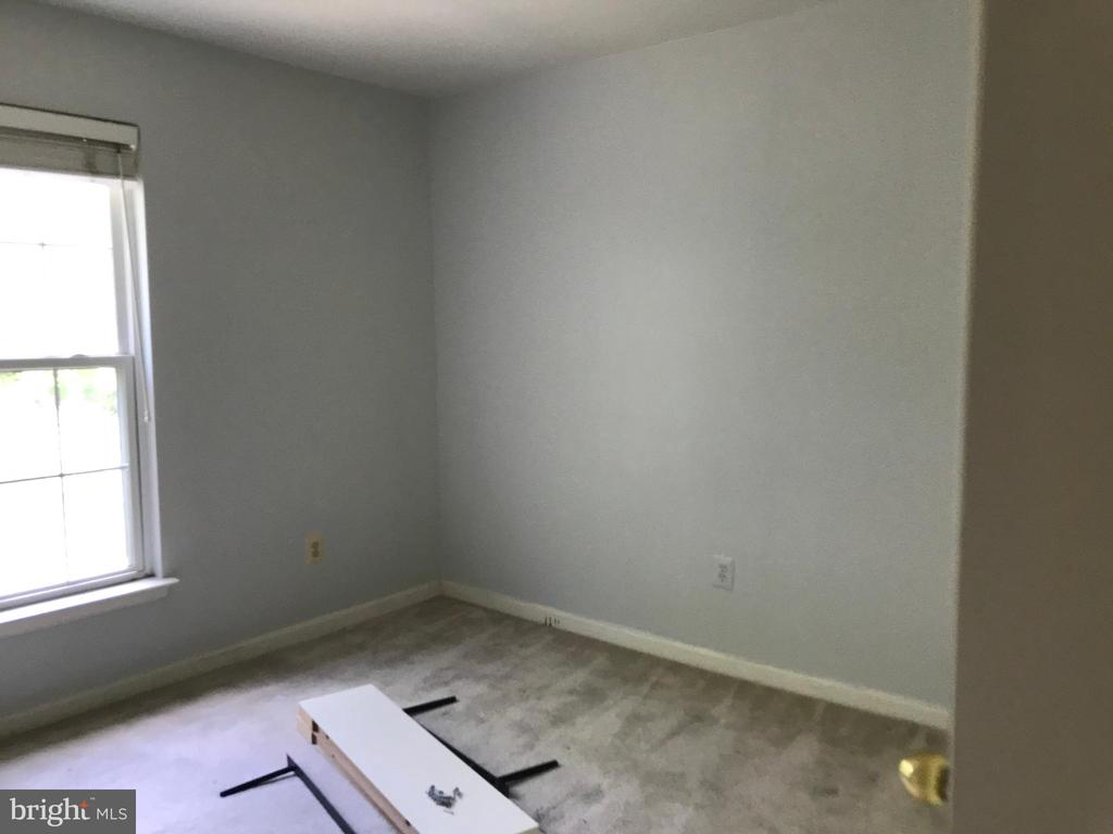 Bedroom 2 has been painted a light gray. - 9812 SPANISH OAK WAY #118, BOWIE