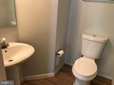 Half bath has been painted a light gray. - 9812 SPANISH OAK WAY #118, BOWIE