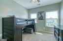 Bedroom with reach in closet and ceiling fan! - 214 WOODSTREAM BLVD, STAFFORD
