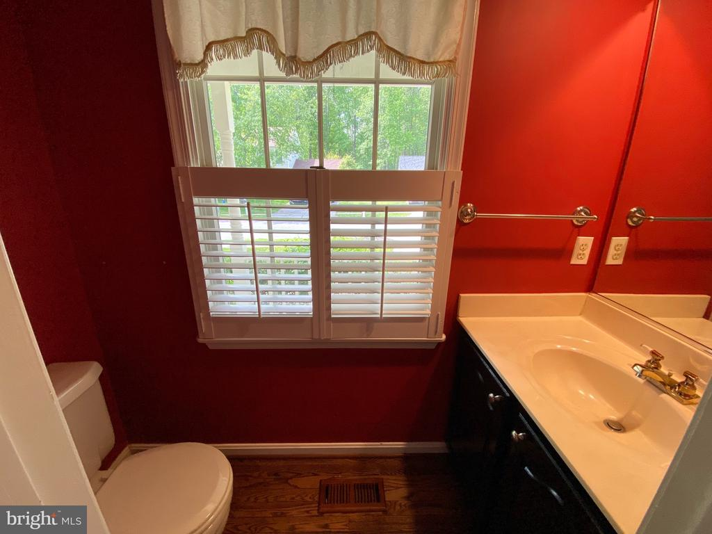 Powder room on main level - 1401 HUNTING WOOD RD, ANNAPOLIS