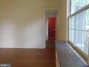 Living Room, rear access to front hall,  bathroom - 2557 36TH ST NW, WASHINGTON
