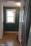Kitchen Entrance and breakfast nook beyond - 2557 36TH ST NW, WASHINGTON
