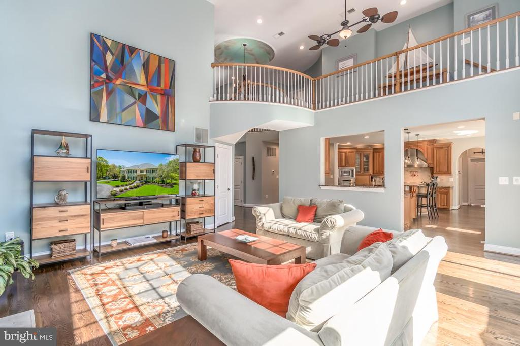 Family room with view of kitchen and upper level - 5400 LIGHTNING DR, HAYMARKET