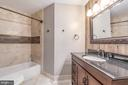 Bedroom 4 full bathroom w/ well-appointed tile - 5400 LIGHTNING DR, HAYMARKET