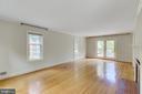 French doors off living room lead to backyard deck - 2401 N VERNON ST, ARLINGTON