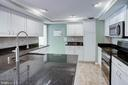 Kitchen with Granite Counters and Tile Backsplash - 1542 DEER POINT WAY, RESTON