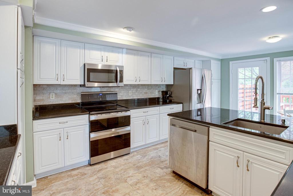 Kitchen with Luxury Vinyl Flooring - 1542 DEER POINT WAY, RESTON