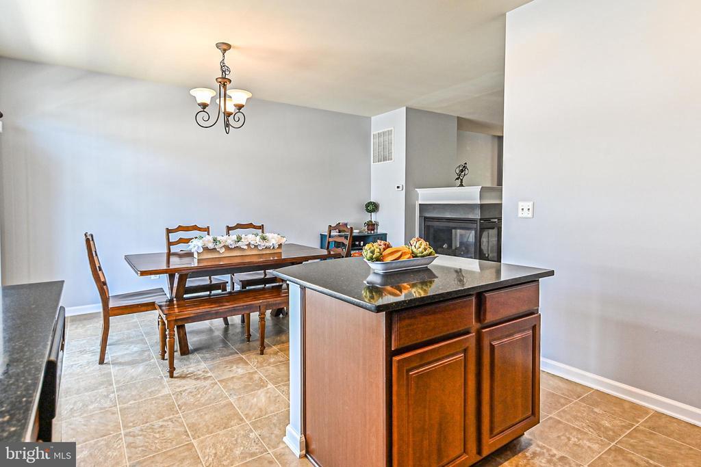 View from kitchen to dining - 22944 ROSE QUARTZ SQ, BRAMBLETON