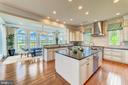 Gourmet kitchen with expansive island - 14732 RAPTOR RIDGE WAY, LEESBURG
