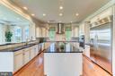 Impressive kitchen has high-end SS appliances - 14732 RAPTOR RIDGE WAY, LEESBURG
