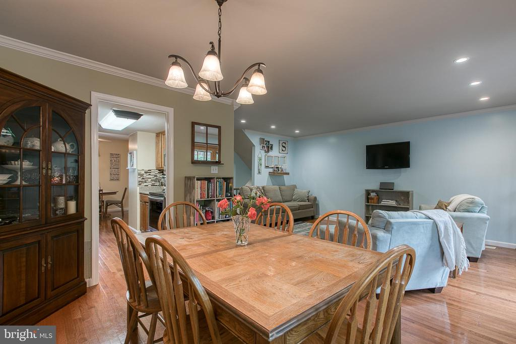 View from dining room into family room. - 12153 STALLION CT, WOODBRIDGE