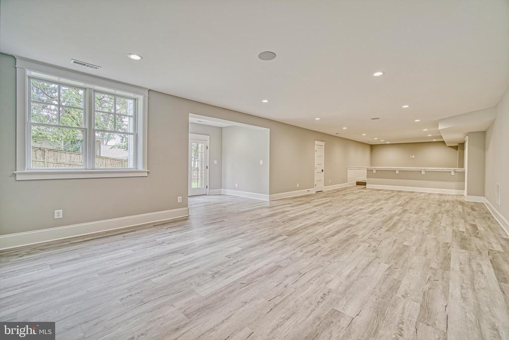 Rec room w/LVT flooring-Same model, diff. location - 3526 N OHIO ST, ARLINGTON