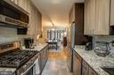 Kitchen opens up to dining room - 363 N ST SW #363, WASHINGTON