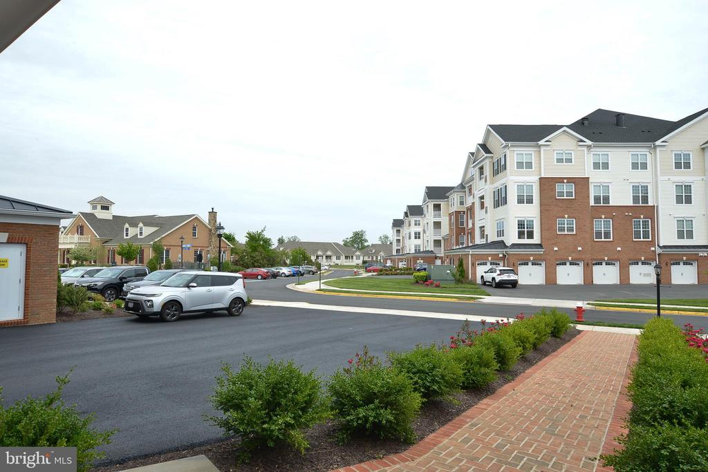 Three cars can park down this driveway. - 20981 ROCKY KNOLL SQUARE #107, ASHBURN
