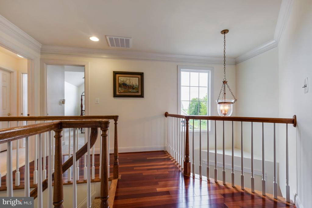 Upper Hallway with Wide Plank Hardwood Floors - 19912 MIZNER TER, ASHBURN