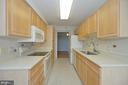 KITCHEN WITH UPGRADED COUNTERTOPS - 19385 CYPRESS RIDGE TER #307, LEESBURG