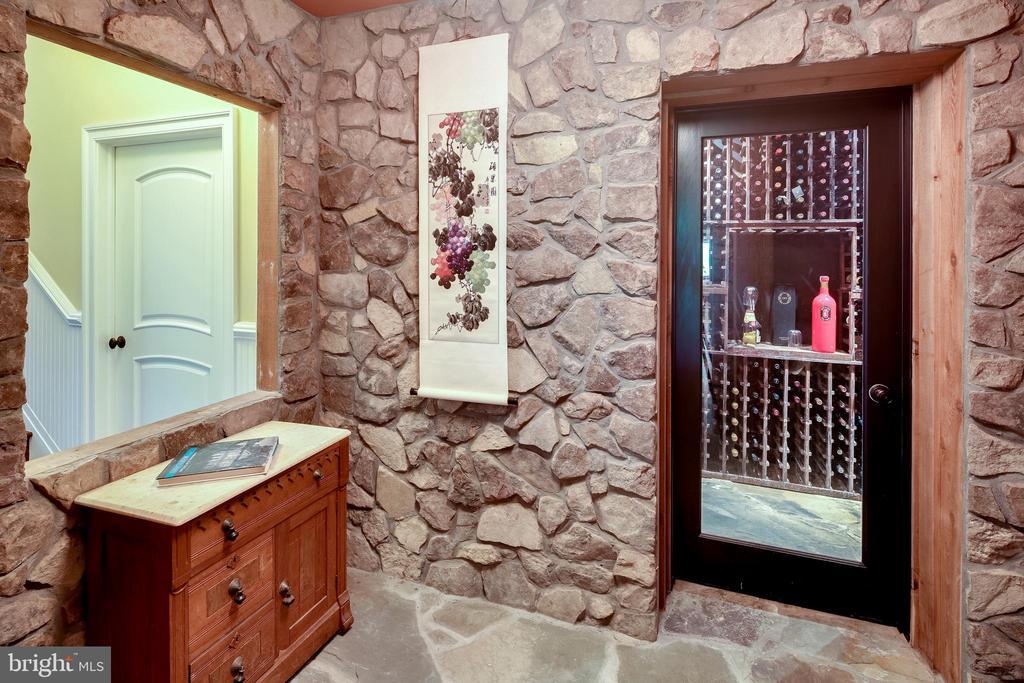 Wine tasting room leading into wine cellar - 809 HOMESTEAD LN, CROWNSVILLE