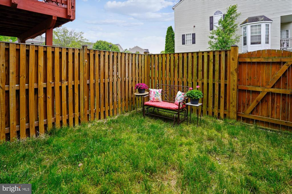 Fenced in backyard right off of your living room! - 16209 TACONIC CIR, DUMFRIES