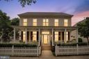 Old-fashioned front porch and white picket fence - 206 WATKINS CIR, ROCKVILLE