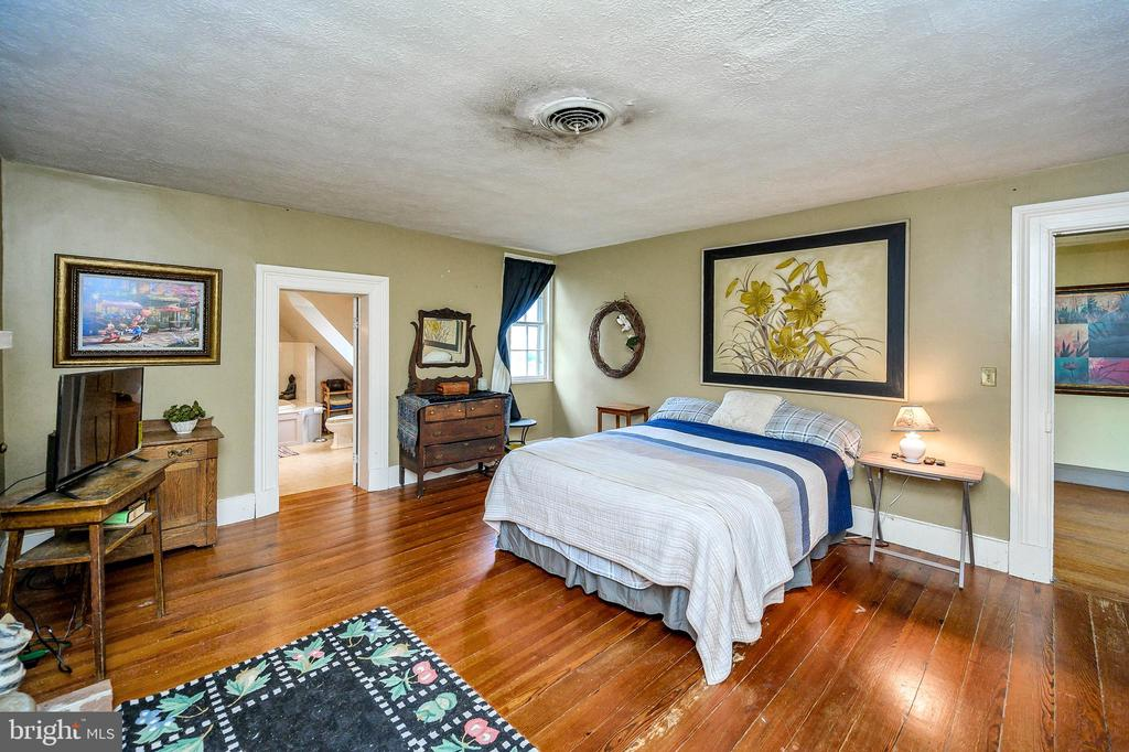 Inviting Master suite with gorgeous wood floors. - 16253 MARQUIS RD, ORANGE