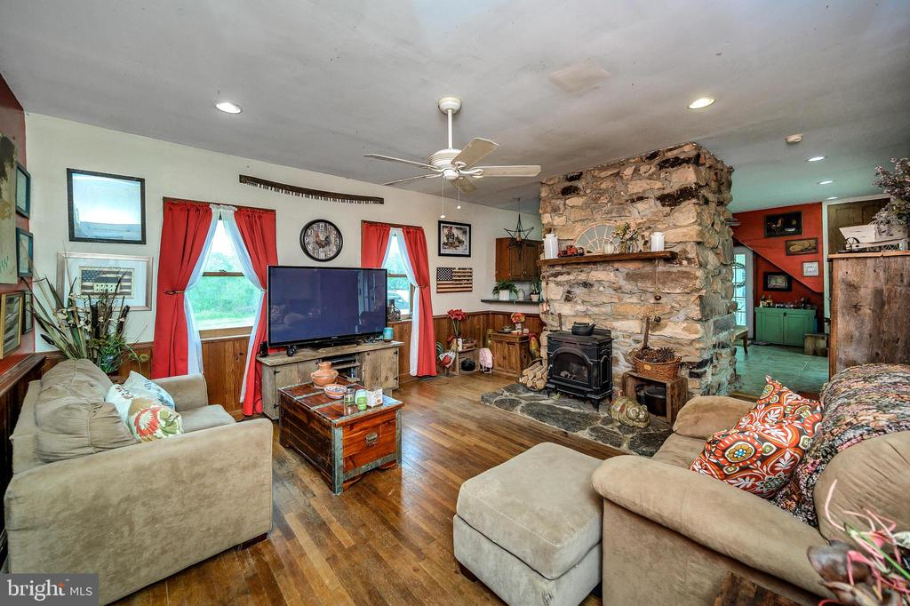 Family room with woods stove insert. - 16253 MARQUIS RD, ORANGE