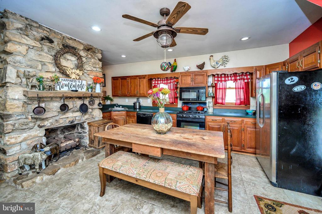 Incredible kitchen with large fireplace - 16253 MARQUIS RD, ORANGE