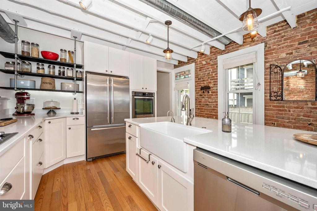 Kitchen offers exposed brick & stainless steel - 18 N WISNER ST, FREDERICK