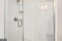 Even the basement bathroom is covered in marble - 4924 BUTTERWORTH PL NW, WASHINGTON