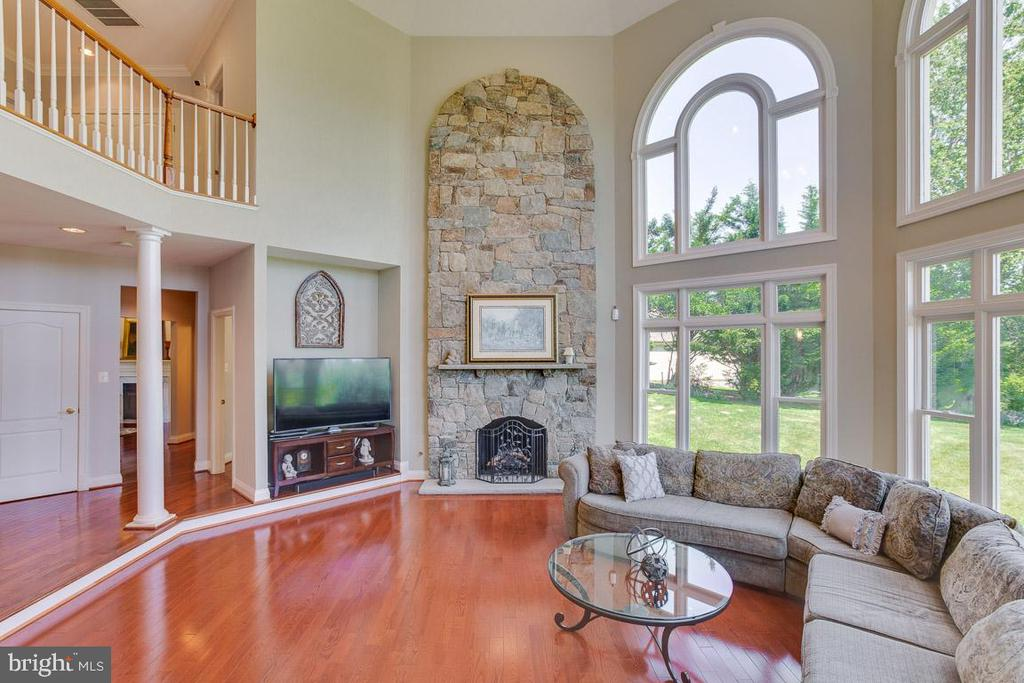 Lovely stone fireplace in family room - 17072 SILVER CHARM PL, LEESBURG