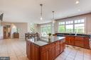 Kitchen with large center island - 17072 SILVER CHARM PL, LEESBURG