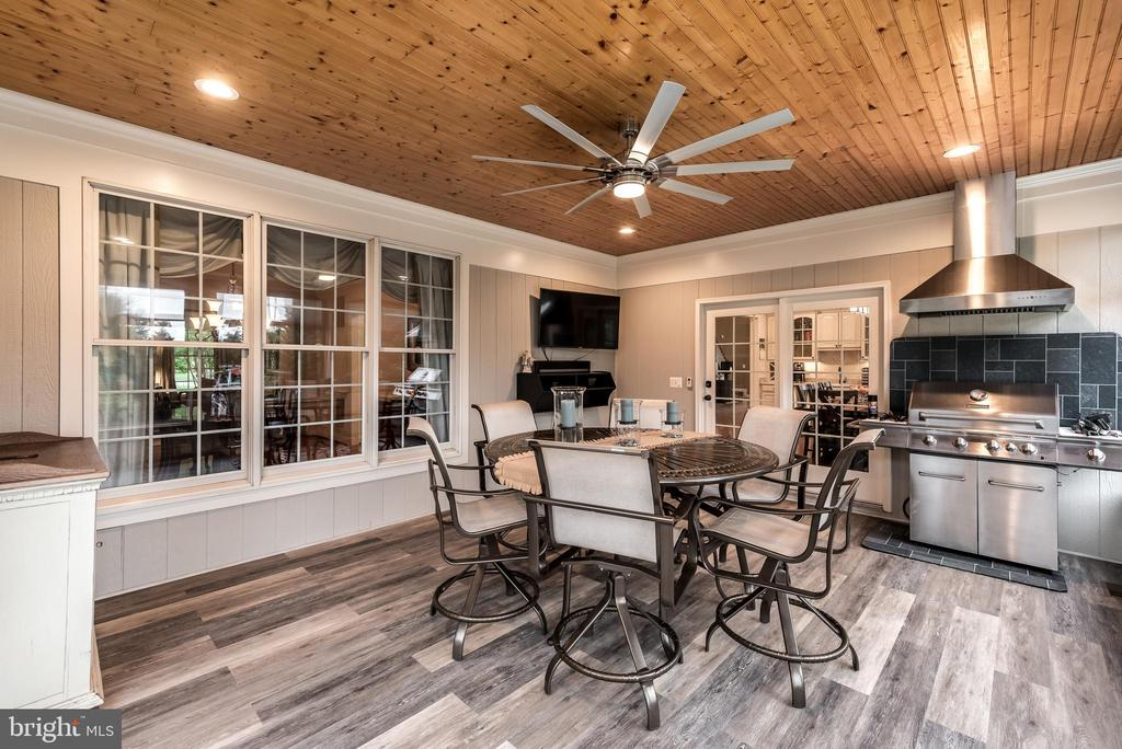 Custom porch with grill center - 15609 RYDER CUP DR, HAYMARKET