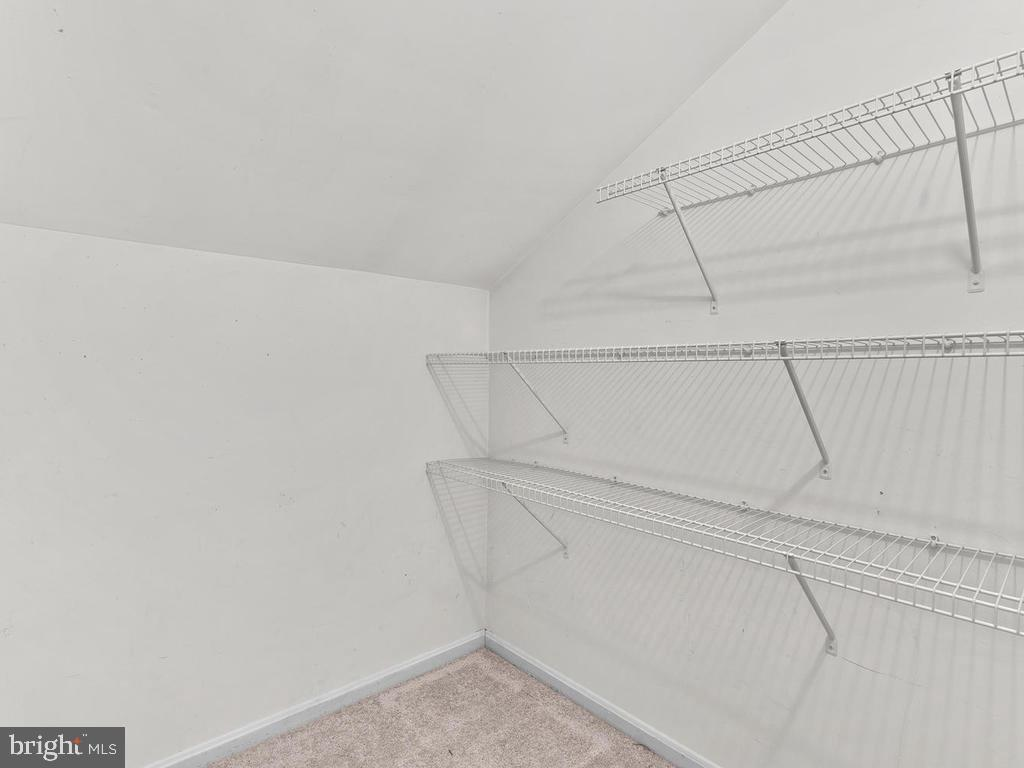 Walk-in closet in the master bedroom. - 1030-B MARGATE CT, STERLING