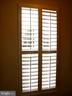 Plantation shutters on main level - 15839 JOHN DISKIN CIR #72, WOODBRIDGE