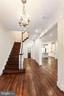 Striking reclaimed hardwood floors vaulted ceiling - 2705 WOODLEY RD NW, WASHINGTON
