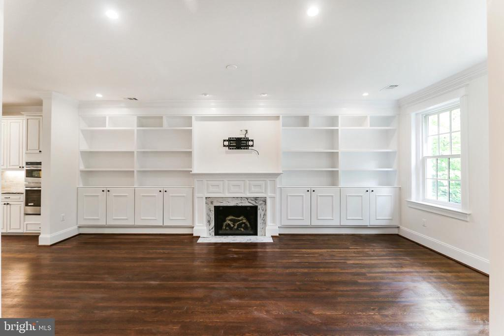 Natural Gas fireplace framed by built-in cabinetry - 2705 WOODLEY RD NW, WASHINGTON
