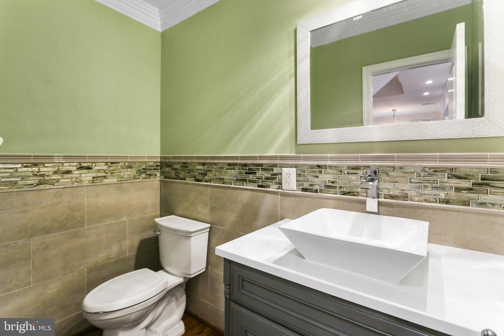 Another  view of main floor Powder Room - 2705 WOODLEY RD NW, WASHINGTON