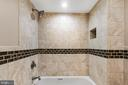 Another view of the  shared bath tub/shower combo - 2705 WOODLEY RD NW, WASHINGTON