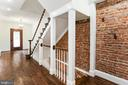 Exposed Brick Accent wall - 2705 WOODLEY RD NW, WASHINGTON