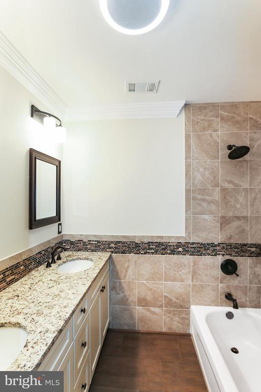 Shared bathroom on upper floor has heated floor - 2705 WOODLEY RD NW, WASHINGTON