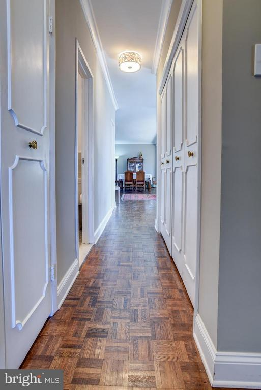 Hall lined with wall of California style closets - 3900 NW WATSON PL NW #A-7C, WASHINGTON