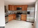 Kitchen with pass through to LR/DR combo - 43955 CHOPTANK TER, ASHBURN
