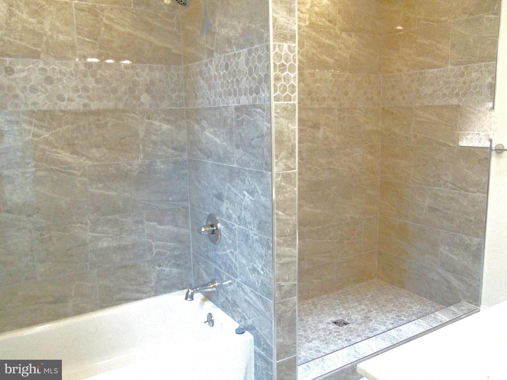 Shower and tub in the master suite - 5710 4TH ST NW, WASHINGTON