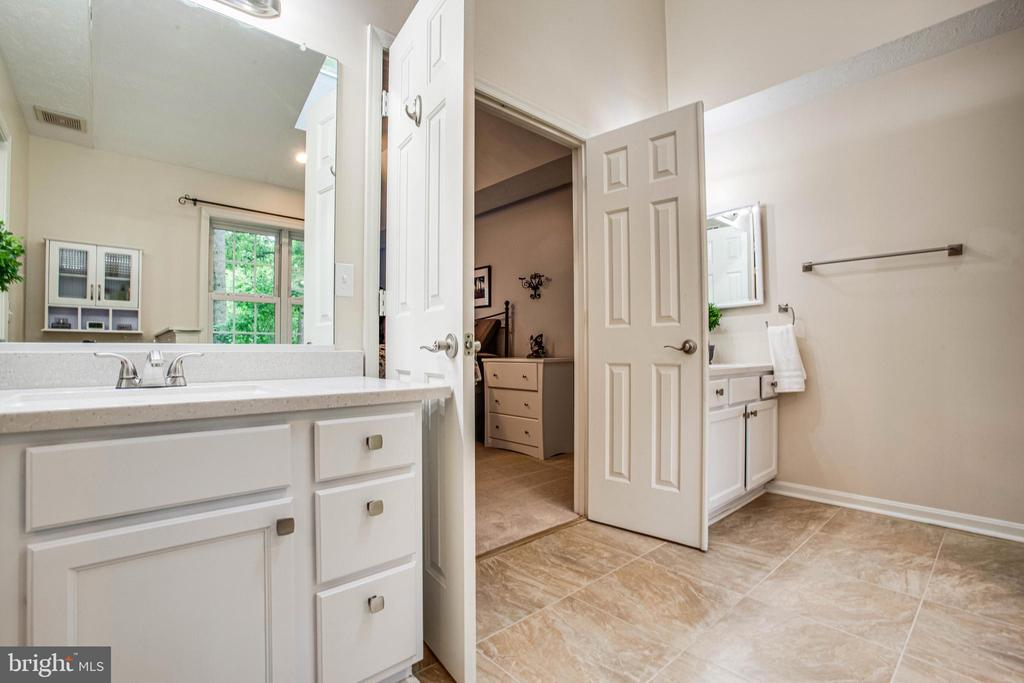 Seperate dual vanities in the master bath - 3408 TITANIC DR, STAFFORD