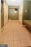 Mud room with bench seating and coat closet - 11331 BRIGHT POND LN, RESTON