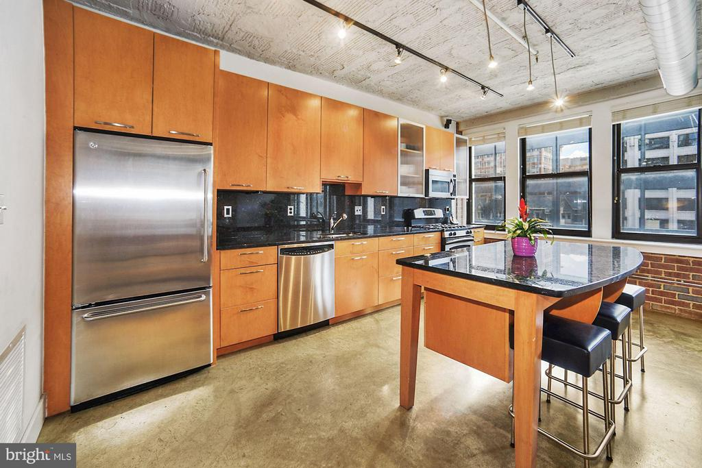 Rich, warm wood cabinets and large kitchen island - 916 G ST NW #401, WASHINGTON