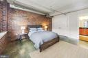 Floor to ceiling exposed brick wall - 916 G ST NW #401, WASHINGTON
