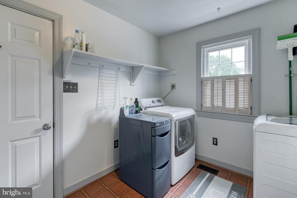 Huge laundry room with cabinet for storage. - 14 STEEPLECHASE RD, FREDERICKSBURG
