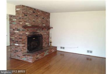 Living Room with fireplace - 10408 BURKE LAKE RD, FAIRFAX STATION