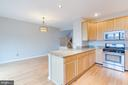 Plenty of space for stools and dining area! - 5266 BALLYCASTLE CIR, ALEXANDRIA